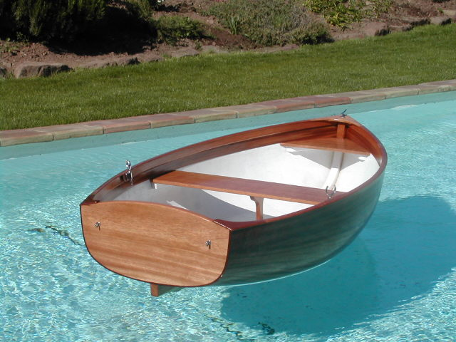 Mahogany tender, with oars, sail or outboard: LOA 2m30, Displacement 40kg