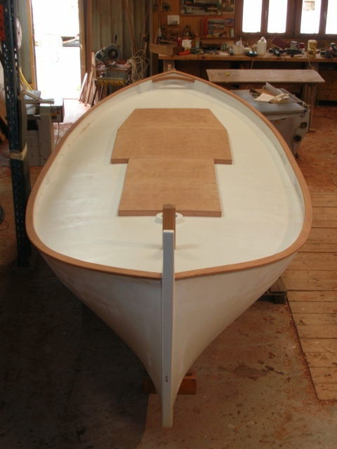 The hatches are in place, the mahogany trim being varnished and the paintwork started…